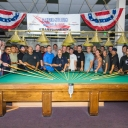 Athletes pose at the billiard table during the 2014 United States Police & Fire Championships in San Diego - the sister event to the WPFG.