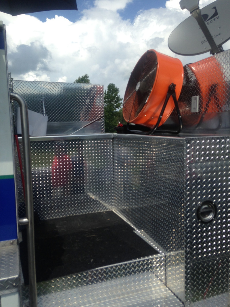 """This guy purchased an old fire truck and transformed it into an incredible custom-made mobile BBQ smoker, bar, and entertainment center. 48"""" HDTVs with DirectTV, full smoker, wet bar from the tank, and more."""